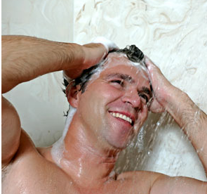 A Man Looking Happy and Washing His Hair
